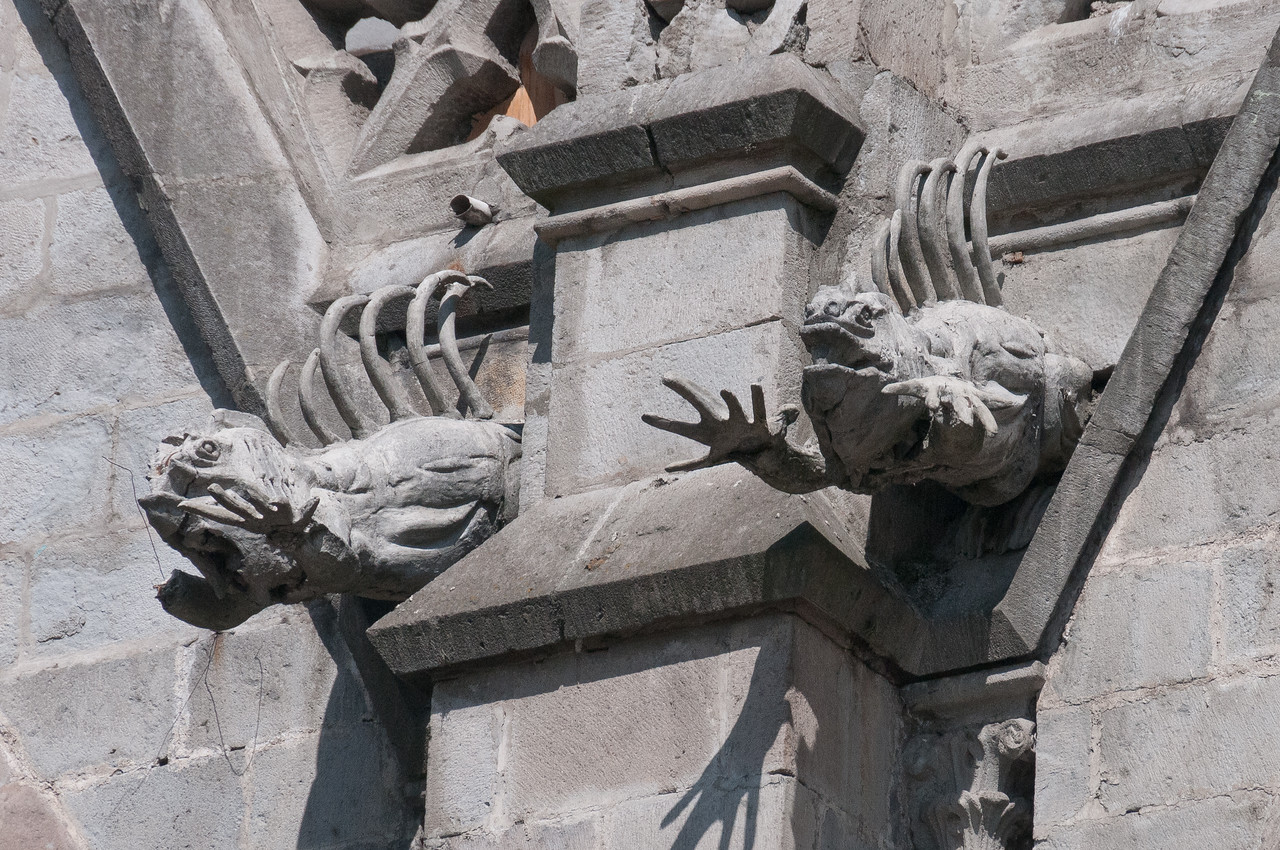 Statues on the walls of the Basilica of the National Vow in Quito, Ecuador