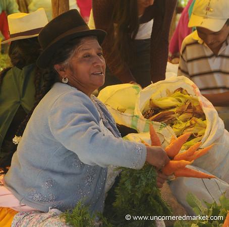 Tying Carrots to Sell - Chordeleg, Ecuador