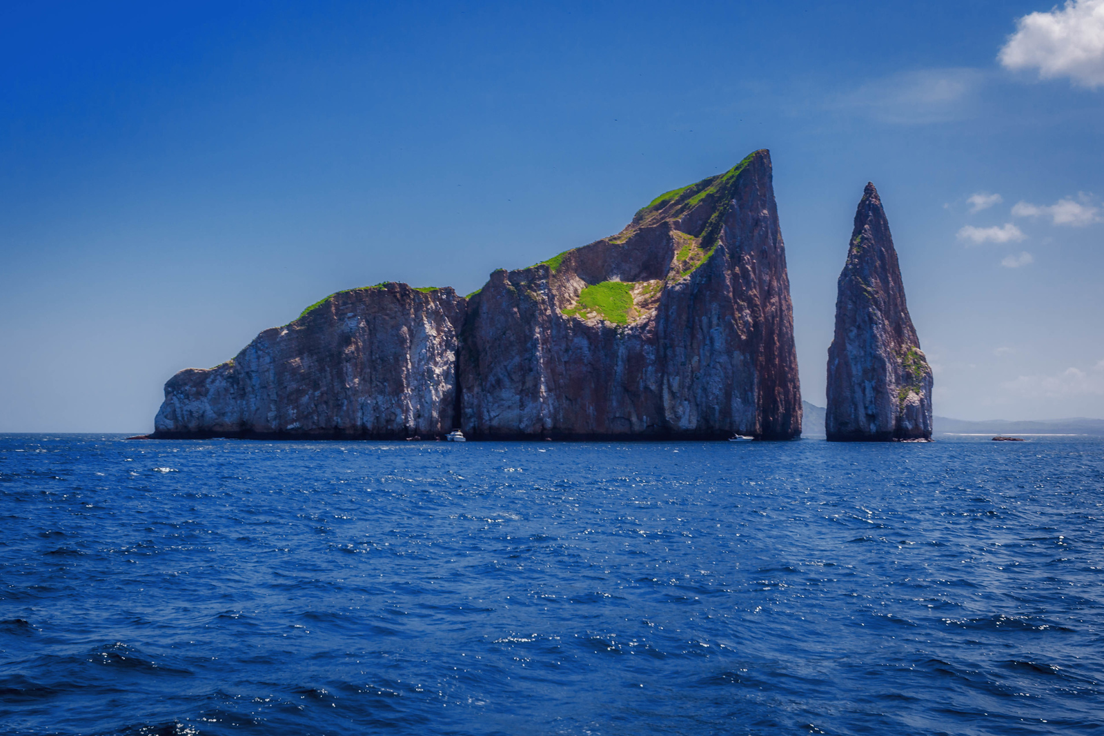 Kicker Rock where you can dive with sharks.