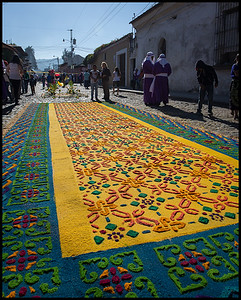 'Alfombra' on an Antigua street, made from coloured sawdust, pine needles, fresh flowers, fruits and vegetables