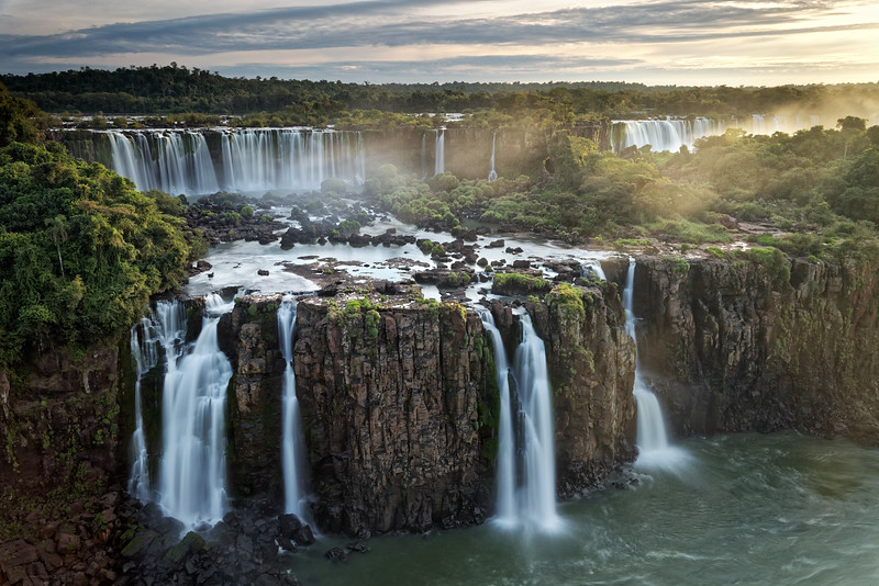 Three Musketeers Falls, and the Rivadavia Falls on the Argentine side at the back. The Three Musketeers Falls can only be viewed from the Brazilian side. Evening light with slow shutter speed