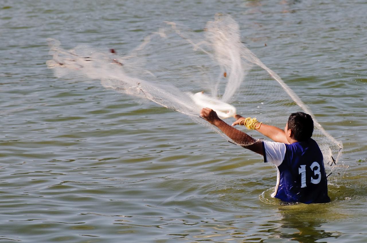 Zihua Net Fisherman
