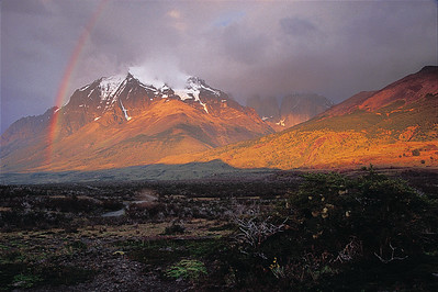 A rainbow following an early morning shower graces Monte Almirante Nieto. Torres del Paine National Park, Patagonia, Chile