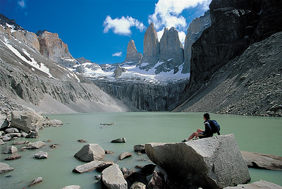 A hiker takes in the beauty at Mirador las Torres. Torres del Paine National Park, Patagonia, Chile