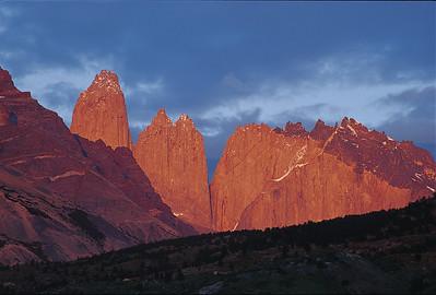 Torres del Paine and Cerro Nido de Condor, sunrise. Torres del Paine National Park, Patagonia, Chile