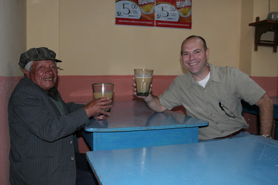 "Drinking ""chicha"" with the locals. Chicha is beer made from fermented maize and served warm."