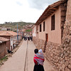 Chinchero<br /> Typical streetscape.<br /> Our first stop will be a weaving cooperative.  Let's see which one has a flag flying.