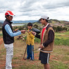 Lago de Huaypo<br /> Vidal engages the boys in conversation and gives them some school supplies.