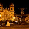 Cusco: Plaza de Armas<br /> Iglesia de la Compañia makes an excellent backdrop for wedding photos.<br /> (This couple is just one of many getting married on this Saturday night before Easter week.)