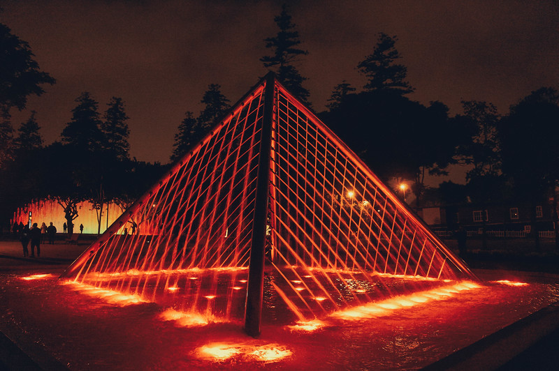 Red pyramid fountain at the Magic Water Circuit in Lima, Peru