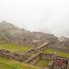 Machu Picchu<br /> A glimpse of the Western Urban Sector through the mist.