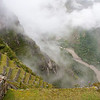 Machu Picchu<br /> Looking down the steep agricultural terraces to Rio Urubamba from the Sacred Plaza.