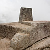 Machu Picchu - Intiwatana<br /> This pillar was thought to be an Intiwatana (hitching post of the sun) by Hiram Bingham.  Archeologists today believe that the four-sided stone would not have cast a useful shadow that could be used in solar observations.