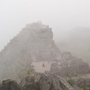 Machu Picchu<br /> Just moments later, the Intiwatana Pyramid and the temples of the Sacred Plaza are shrouded in fog.