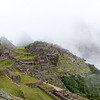 Machu Picchu<br /> Huayna Picchu and Uña Picchu are shrouded in fog, but at least we can see parts of the sanctuary.