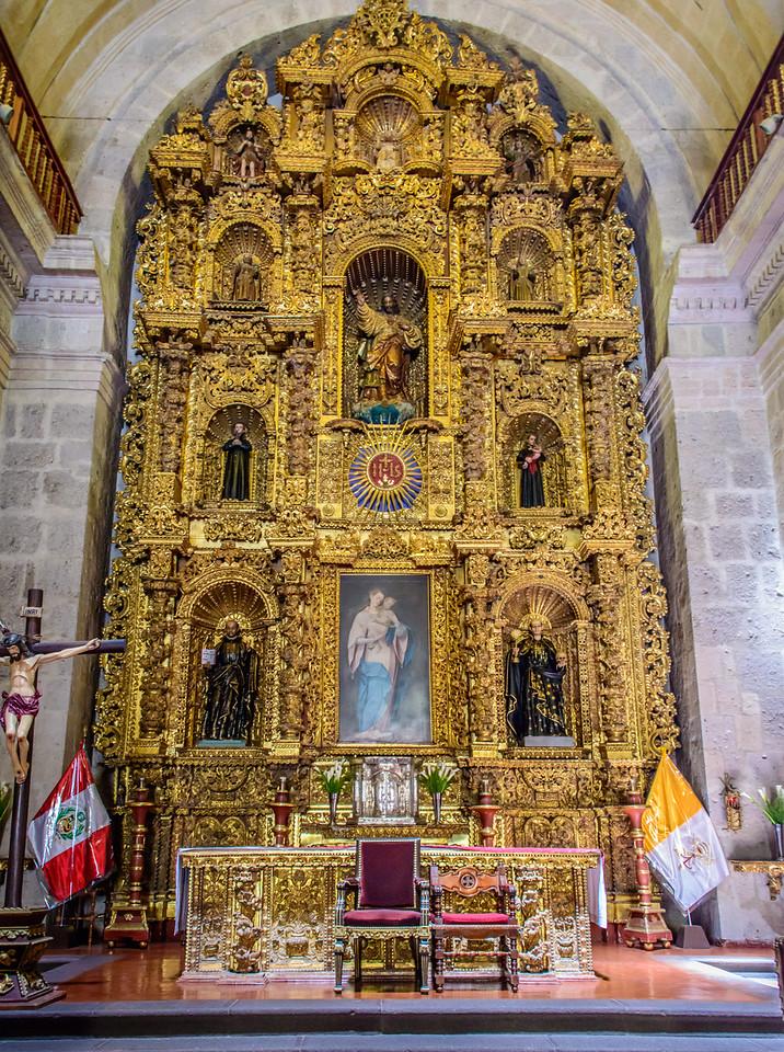 Iglesia de la Compania carved cedar main alter with gold leaf