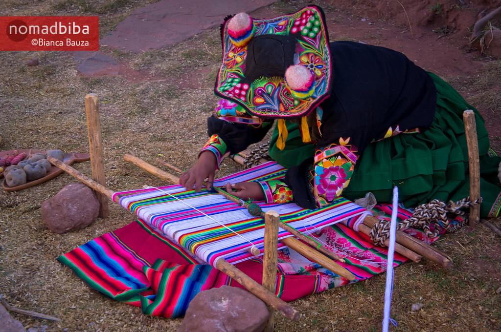 Woman weaving in Llachón near Puno, Peru