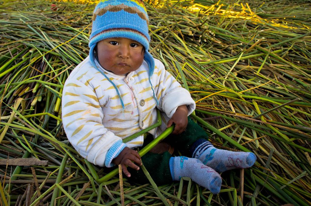 Baby at Uros Islands in Peru