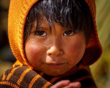 Stunning portrait of a kid shot on the intriguing floating islands. Impressive look and sharpness in the eyes.