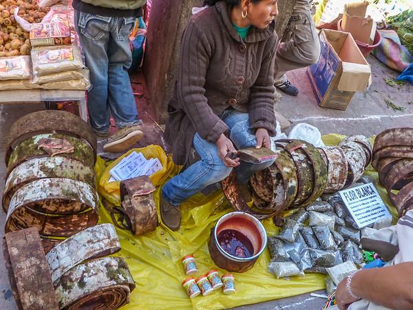 "Vendor selling ""Dragon's Blood"" (Sangre de Drago) - Mercado Central de San Pedro, Cusco, Peru"