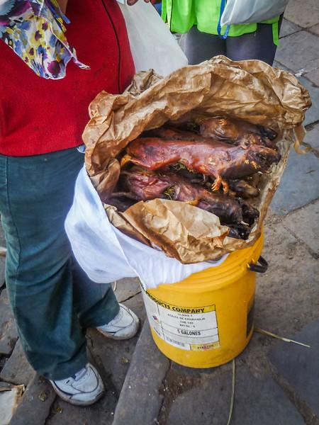 Vendors selling roasted guinea pig (cuy) | San Pedro Market (Mercado Central de San Pedro), Cusco, Peru