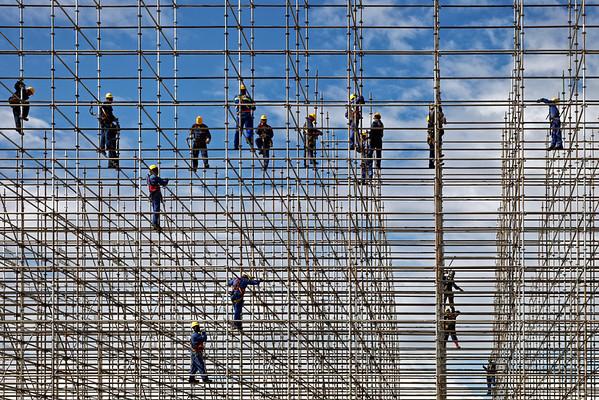 Rio scaffolders building the Olympic beach volleyball court on Copacabana Beach