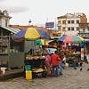 with vendors arranged around the open plaza...