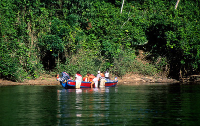 Central Suriname Nature Reserve - Coppename River, tourists pushing boat #2