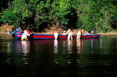 Central Suriname Nature Reserve - Coppename River, tourists pushing boat