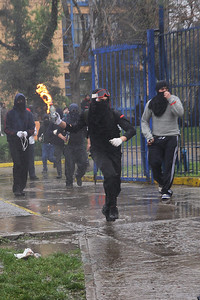 Student from the Univ. of Chile protest the killing of an elder Mapuche and his son (Panetta)