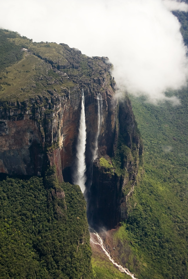 """Angel Falls as """"seen"""" from the air.  <br /> <br /> I put quotes around that word because I didn't actually get to see this as I shot it - it was on the other side of the aircraft from me.  I held my camera across the little Cessna over the pilot's shoulder and blind-fired about four shots.  Amazingly, not only did I get the falls in the shot, the composition wasn't too bad!<br /> <br /> If you can't be good, you might as well be lucky...<br /> <br /> Location: Angel Falls, Venezuela<br /> <br /> Lens used: 28-135mm f3.5-5.6 IS"""