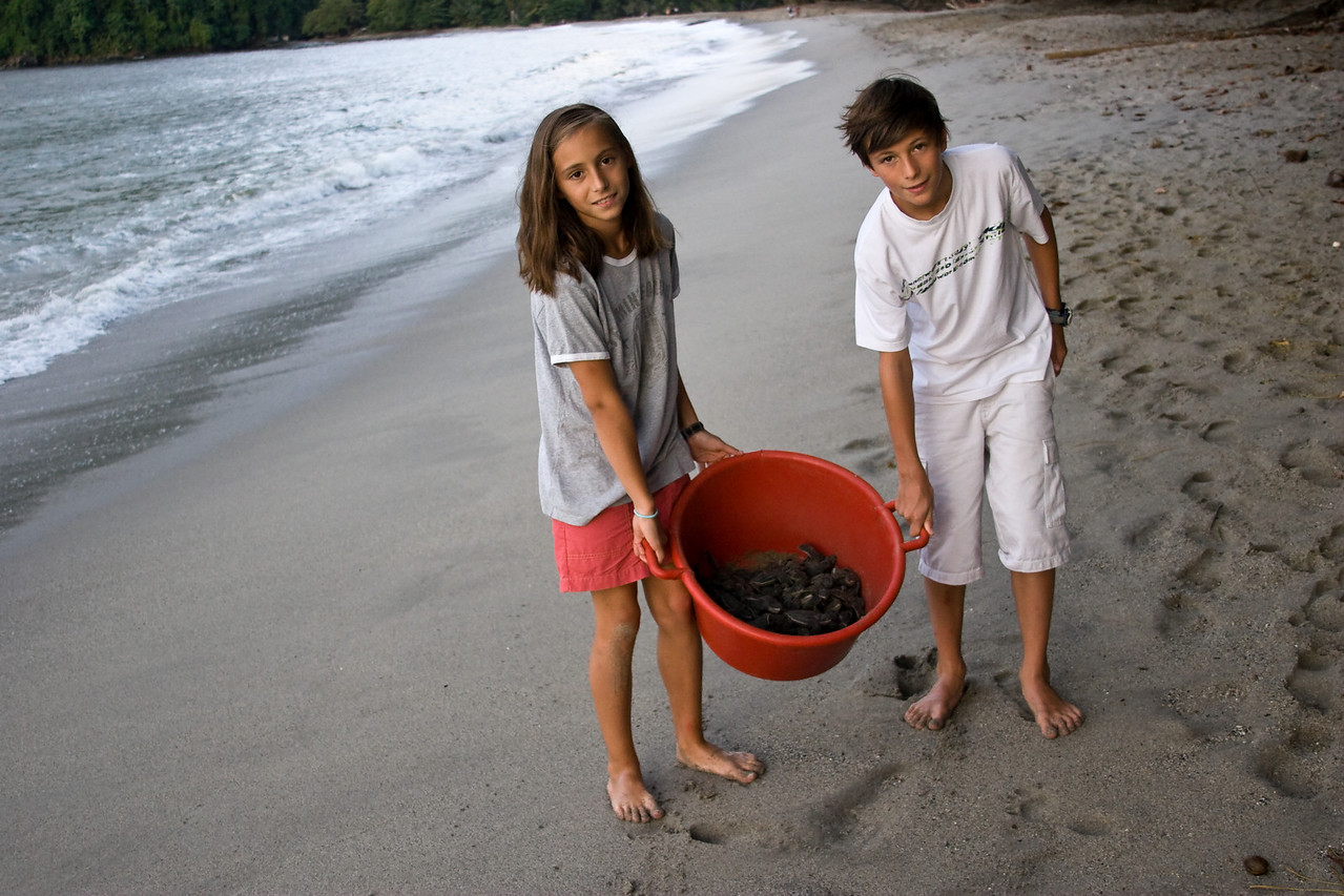 These French kids helped me load up (and carry!) the bucket of baby Leatherback turtles we found hatching on the beach back to the turtle center.<br /> <br /> Location: Grande Riviere, Trinidad<br /> <br /> Lens used: 28-135mm f3.5-5.6 IS