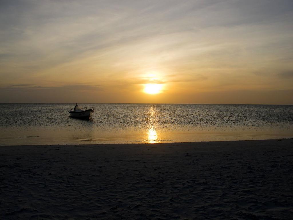 "Boat at sunset time in Isla de Coche, Venezuela For the story, check out: <a href=""http://www.nomadbiba.com/wp/2011/03/isla-de-coche-a-break-from-rutine/"">Isla de Coche, a break from routine</a>"