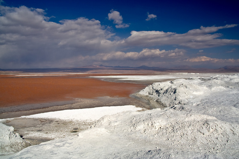 Red Lake and Borax Dunes<br /> <br /> This whole part of the world makes you feel like you're walking through a Salvador Dali painting. The red lake is surrounded by giant dunes of borax that go on for miles.