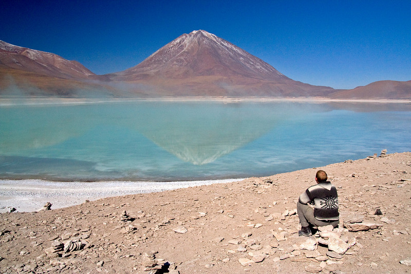 John checking out Lincancabur Volcano<br /> <br /> Lincancabur Volcano (5,900 m, 19,400 ft) sits on the border between Bolivia and Chile. It's crater holds one of the highest lakes in the world.