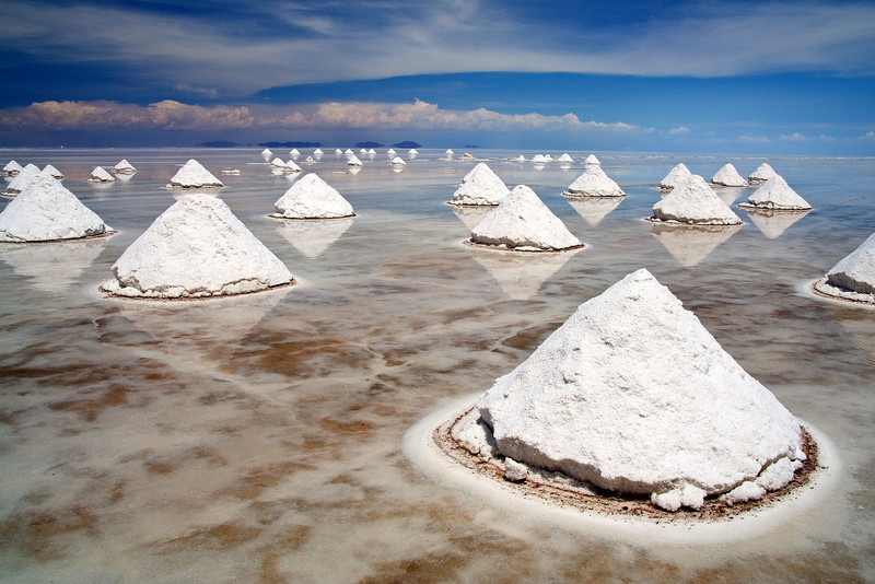 Salt Mounds - Salar de Uyuni, Bolivia<br /> <br /> These mounds are piles of drying salt. Underneath them sits the 10,000 square km Salar de Uyuni, the world's largest salt flat. At at altitude of 3,600 m (11,800 ft), the Salar is the remnant of an ancient inland sea.<br /> <br /> During the wet season a thin layer of water covers the flat, causing reflections and optical illusions.