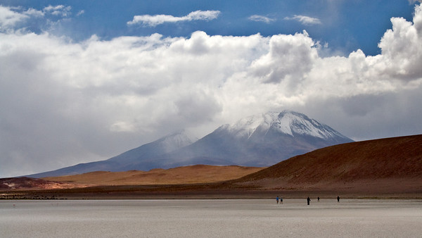 Volcano and Salt Flat - Bolivia  A volcano rises behind a 4,000 m high salt flat.