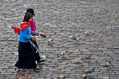 Indigenous women crossing Plaza de San Francisco - Quito, Ecuador