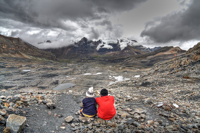 Mountain children looking out on their backyard - Cordillera Blanca, Peru  The Cordillera Blanca is home to many indigenous people, yet remains almost completely undeveloped. The spot where these kids are sitting is around 5,200 m (17,000 ft) in elevation.