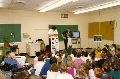 South Burlington Fire Department Scanned Cataloged image of members conducting fire safety education in local school  location unknown.
