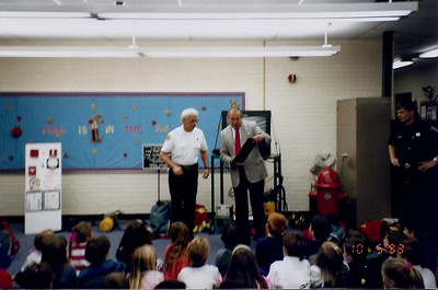 South Burlington Fire Department Scanned Cataloged image of members conducting fire safety education in local school.