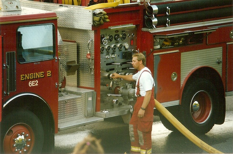 Scanned Catalog Image of members working at Structure Fire.