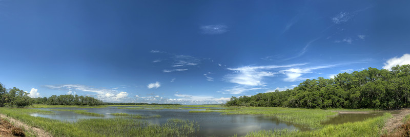 View across the coastal salt marshes from the dike at Jason's Lake at Botany Bay Plantation Heritage Preserve and Wildlife Manager Area in Edisto Beach, SC on Friday, July 19, 2013. Copyright 2013 Jason Barnette