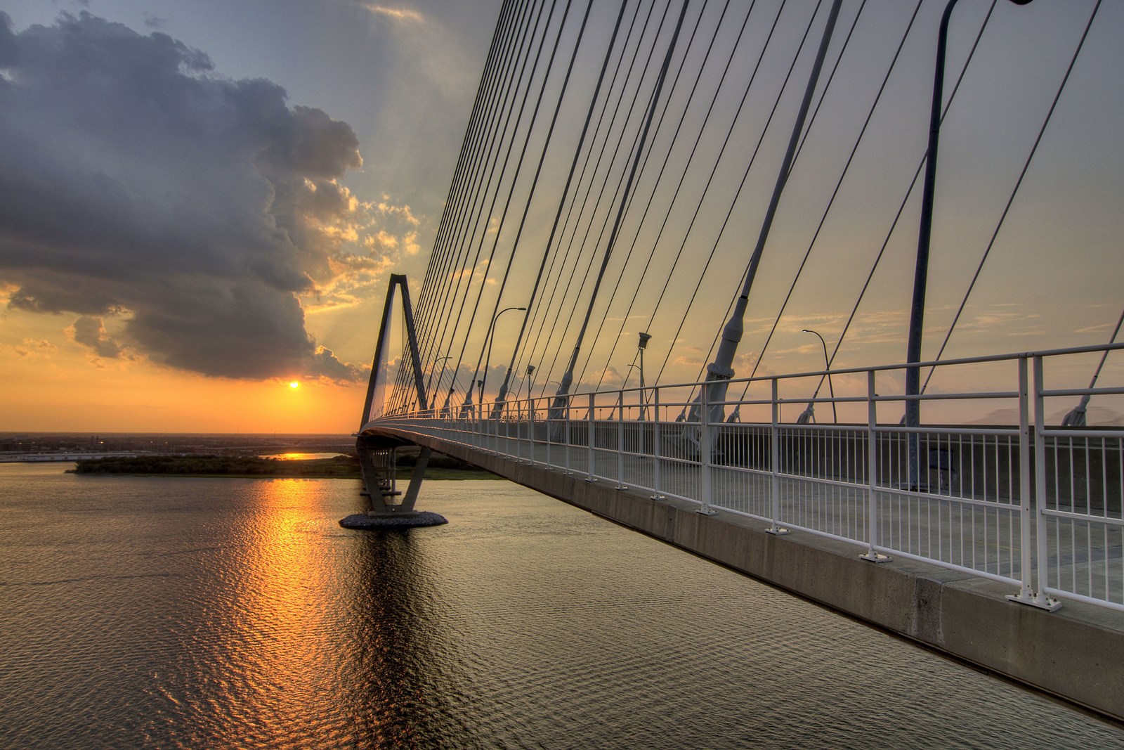 A brilliant sunset across the Cooper River, seen from Wonders' Way on the Arthur Ravenel, Jr. Bridge in Charleston, SC on Sunday, September 8, 2013. Copyright 2013 Jason Barnette