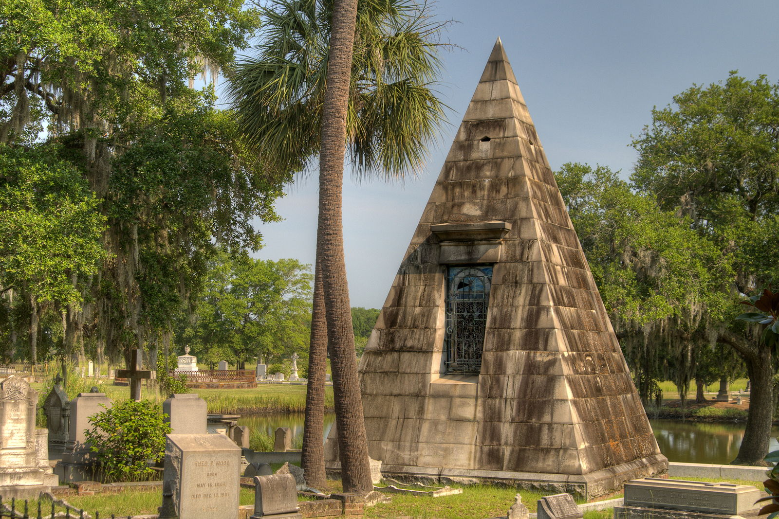 An interesting pyramidal mausoleum, resting home for William Smith and his wife Frances Susan, at Magnolia Cemetery in Charleston, SC on Wednesday, July 9, 2014. Copyright 2014 Jason Barnette The cemetery was dedicated in 1850 and includes many beautiful examples of architecture and unique mausoleums. The cemetery is also the final resting place of the H.L. Hunley crew, buried with full military honors in 2004.