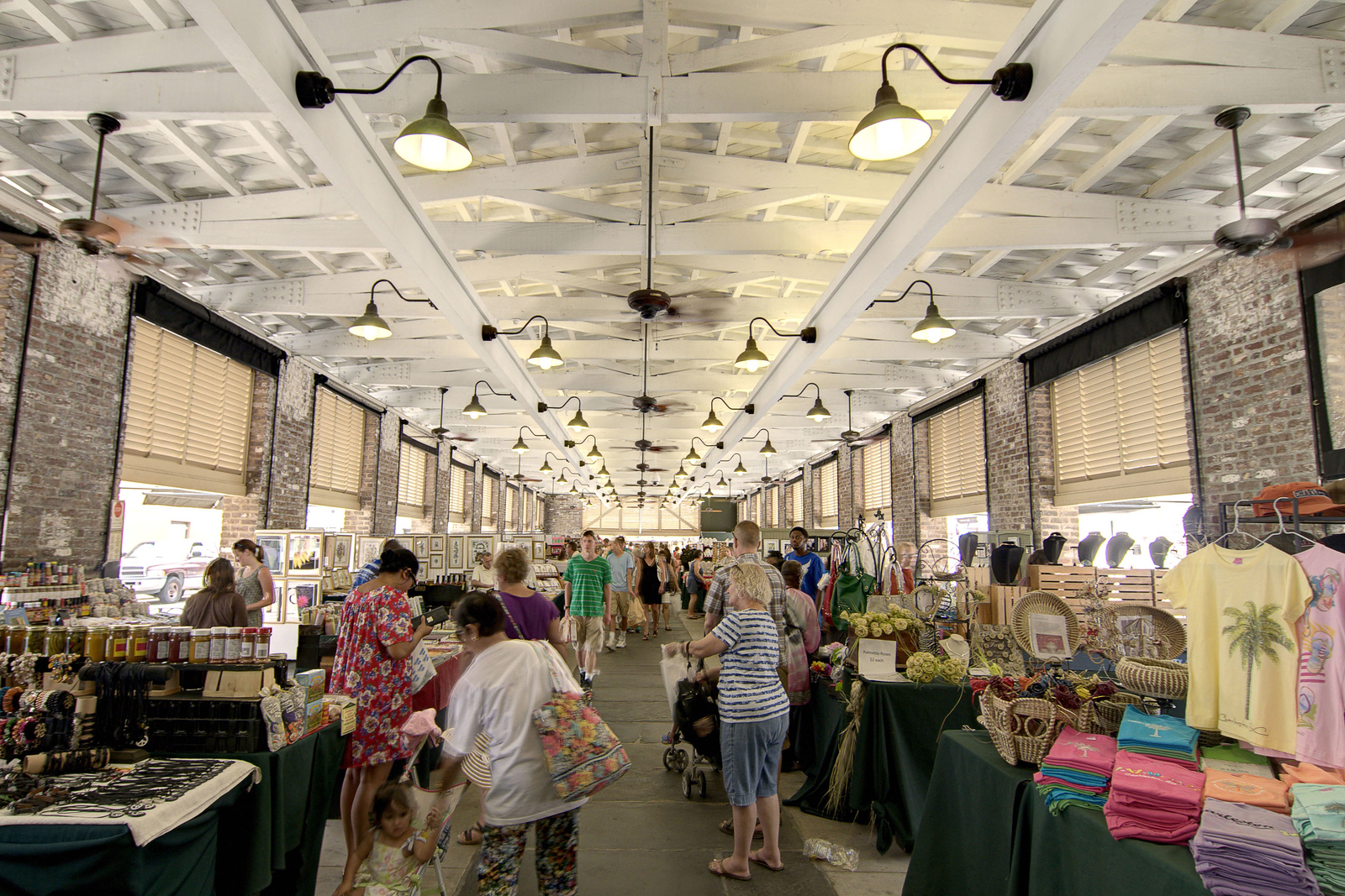 People browse for locally-made arts, crafts, and baked goods at the City Market in downtown Charleston, SC on Tuesday, July 8, 2014. Copyright 2014 Jason Barnette