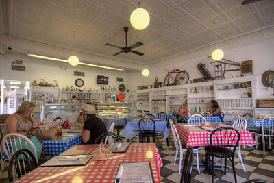 Several small tables and a few diners at The Trestle Bakery and Cafe in Conway, SC on Tuesday, July 15, 2014. Copyright 2014 Jason Barnette