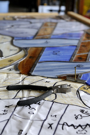 A large stained glass window under construction at Conway Glass in Conway, SC on Monday, September 1, 2014. Copyright 2014 Jason Barnette