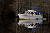 A boat drifts in the Waccamaw River in Conway, South Carolina on Friday, November 18, 2011. Copyright 2011 Jason Barnette
