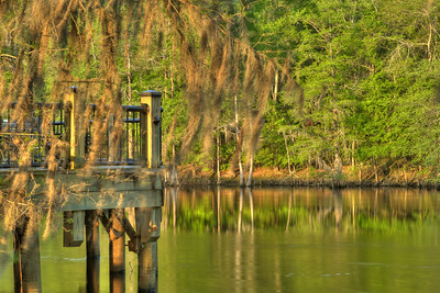 The late evening sunlight creates a bright, calm atmosphere along the Riverwalk in Conway, SC on Wednesday, April 8, 2015. Copyright 2015 Jason Barnette